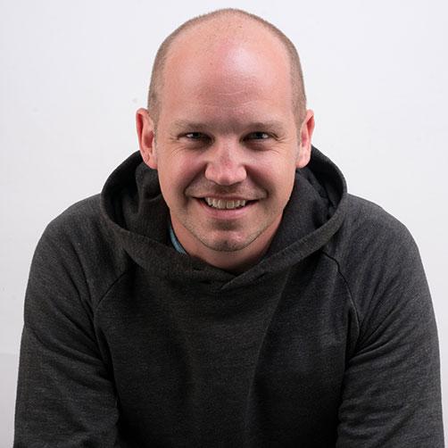 A headshot of Josh Summers